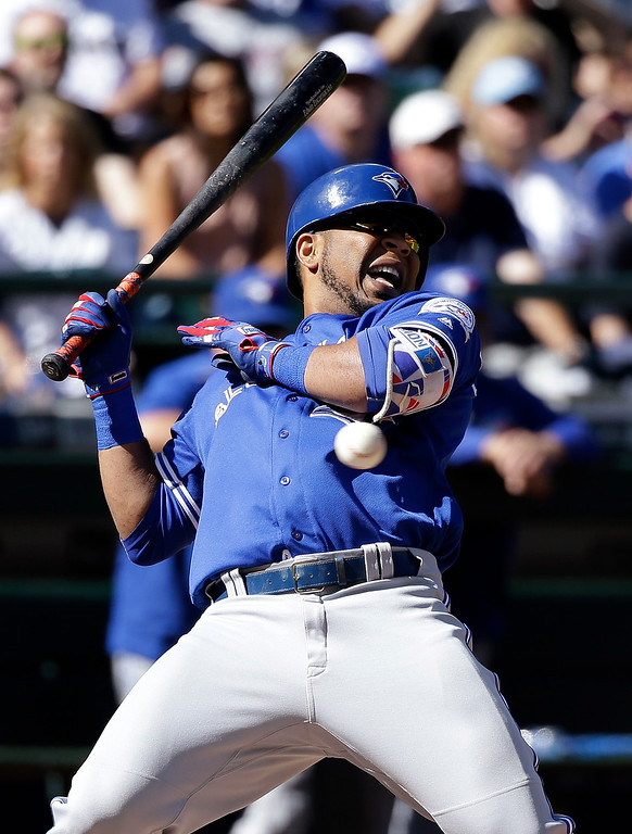 . Toronto Blue Jays\' Edwin Encarnacion backs away from an inside pitch against the Seattle Mariners in the fourth inning of a baseball game Wednesday, Sept. 21, 2016, in Seattle. Encarnacion grounded out on the turn. (AP Photo/Elaine Thompson)