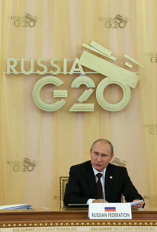 . Russia\'s President Vladimir Putin makes opening comments during a round table meeting at the G-20 summit in St. Petersburg, Russia on Thursday, Sept. 5, 2013. (AP Photo/Sergei Karpukhin, Pool)