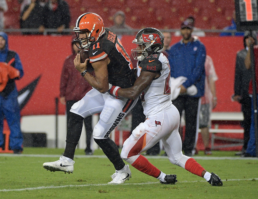 . Cleveland Browns wide receiver Jordan Leslie (11) eludes Tampa Bay Buccaneers cornerback Mariel Cooper for a 5-yard touchdown reception during the fourth quarter of an NFL preseason football game Saturday, Aug. 26, 2017, in Tampa, Fla. The Browns won the game 13-9. (AP Photo/Phelan Ebenhack)