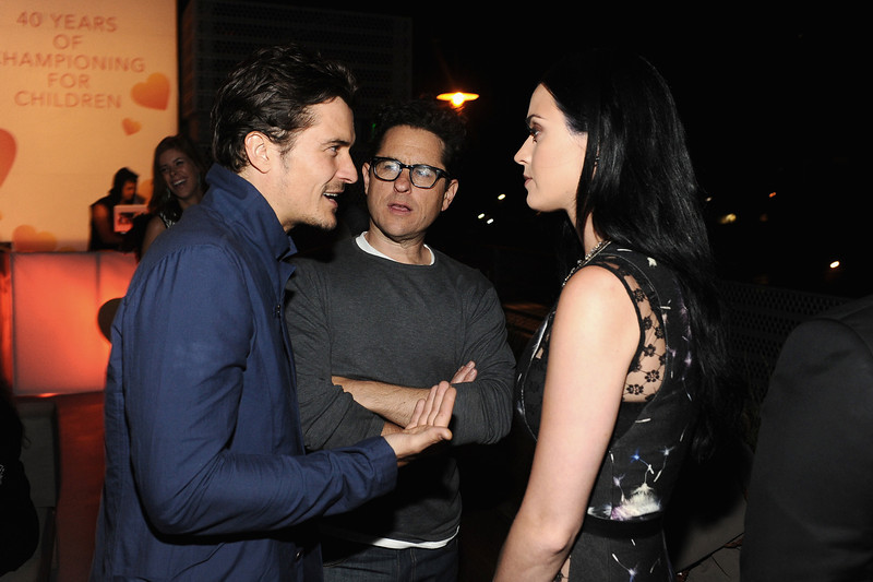 . Actor Orlando Bloom, host J.J. Abrams, and singer Katy Perry attend Coach\'s 3rd Annual Evening of Cocktails and Shopping to Benefit the Children\'s Defense Fund hosted by Katie McGrath, J.J. Abrams and Bryan Burk at Bad Robot on April 10, 2013 in Santa Monica, California.  (Photo by Stefanie Keenan/Getty Images for Coach)