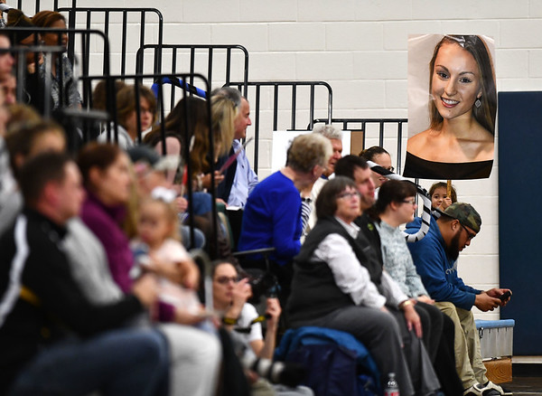 11/1/2019 Mike Orazzi | StaffrA fan of Bristol Easterns Rebecca Bender (3) hold up a poster on senior night during Friday night's girls volleyball match with Lyman Memorial in Bristol.