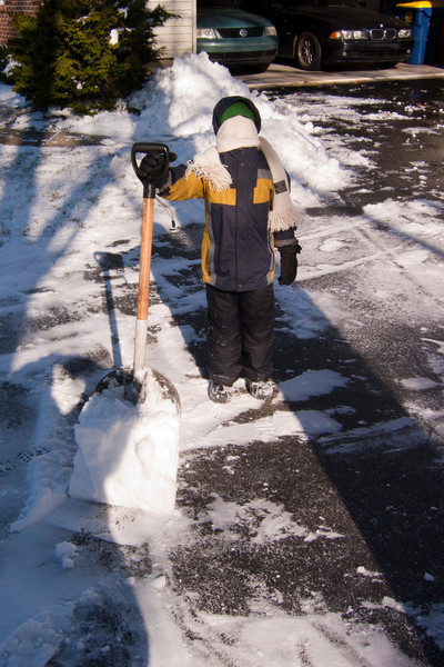 """K.C. gives us his """"no exposed skin"""" look as he takes a shoveling break in the 30 mph winds."""