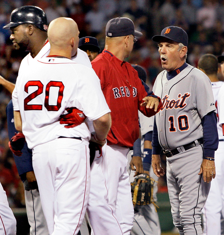 . Detroit Tigers manager Jim Leyland (10) has words with Boston Red Sox manager Terry Francona, center, as Boston Red Sox\'s  Kevin Youkilis (20) is held back by teammate David Ortiz, left, after the benches cleared when Youkilis was hit by a pitch from Detroit Tigers starter Rick Porcello in the second inning of their baseball game at Fenway Park in Boston, Tuesday, Aug. 11, 2009. (AP Photo/Elise Amendola)