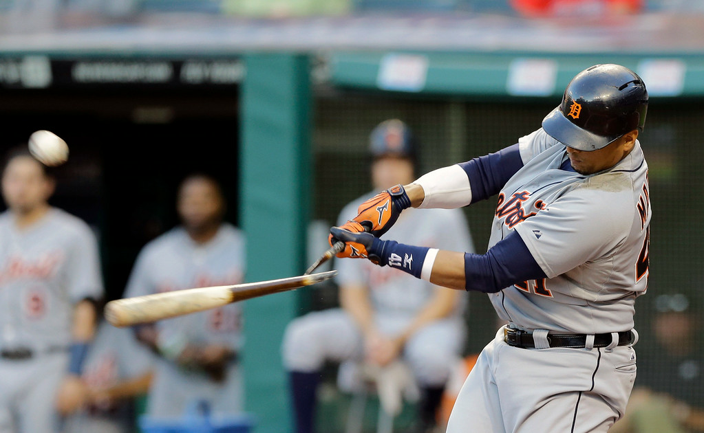 . Detroit Tigers\' Victor Martinez breaks his bat off a throw from Cleveland Indians starting pitcher Danny Salazar in the first inning of a baseball game, Wednesday, Sept. 3, 2014, in Cleveland. Martinez was out on the play. (AP Photo/Tony Dejak)