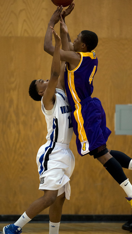 . Oakland Technical High School\'s Pooh Woodfolk (4) shoots over Oakland defender Justin Gaines (12) during the second quarter of their Oakland Athletic League semi-final tournament game, Tuesday, Feb. 26, 2013 in Oakland, Calif. Oakland won, 70-58. (D. Ross Cameron/Staff)