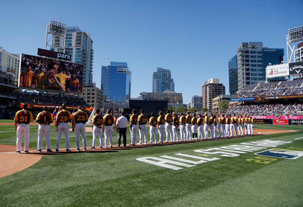 . The U.S. Team lines up during the National Anthem prior to the All-Star Futures baseball game, Sunday, July 10, 2016, in San Diego. (AP Photo/Lenny Ignelzi)