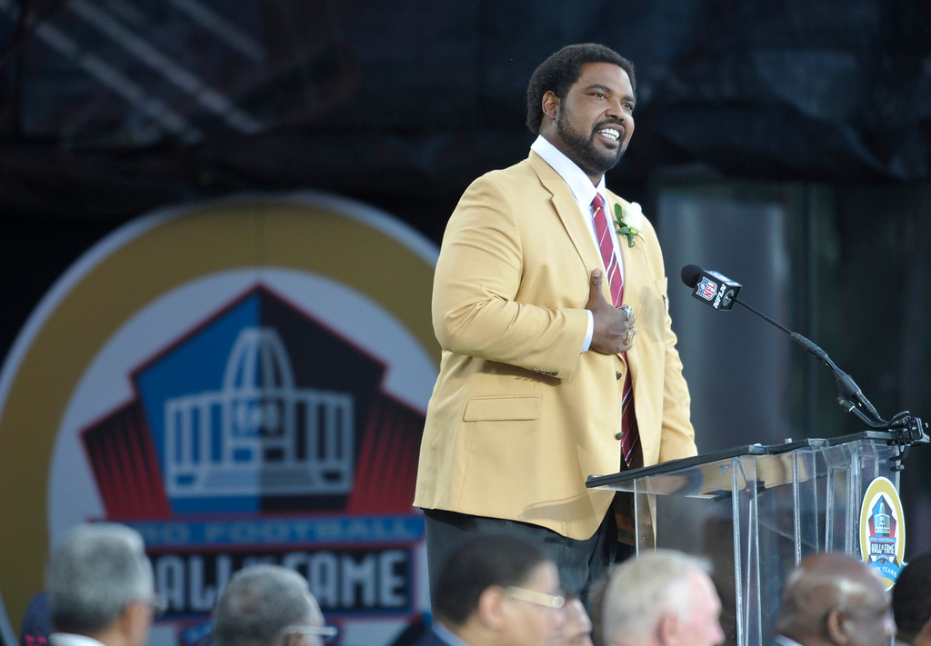. Former Baltimore Ravens player Jonathan Ogden speaks during the induction ceremony at the Pro Football Hall of Fame Saturday, Aug. 3, 2013, in Canton, Ohio. (AP Photo/David Richard)
