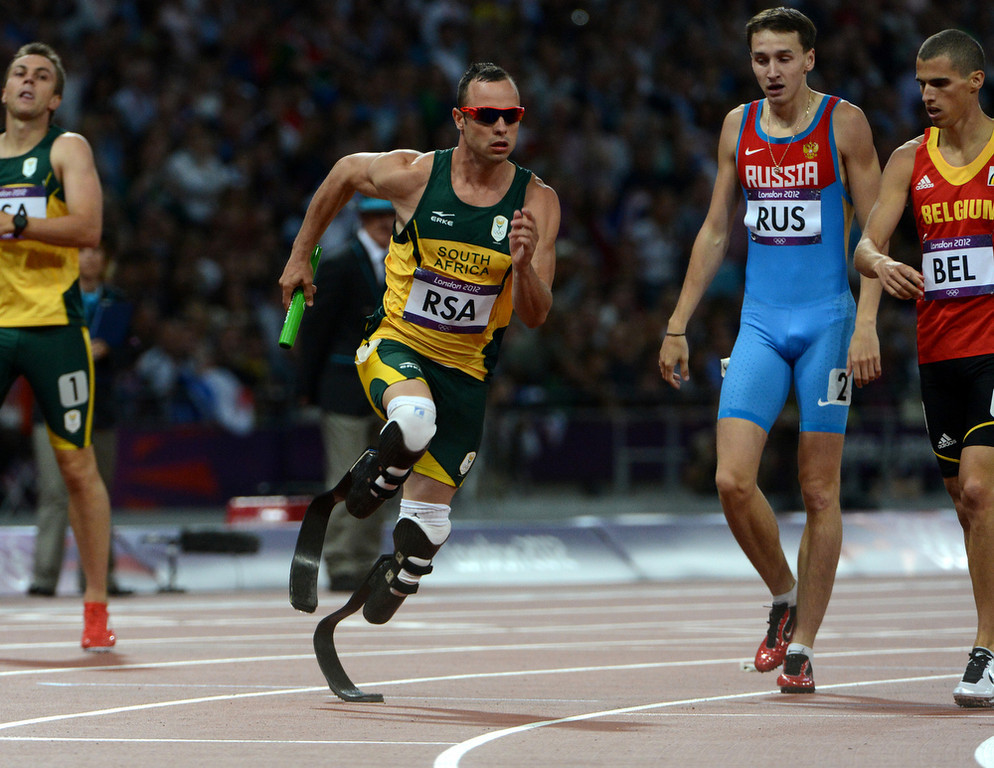 . South Africa\'s Oscar Pistorius runs the final leg for South Africa for the Men\'s 4x400m Relay at the Olympic Stadium for the London 2012 Olympics in London, England on Friday, Aug. 10, 2012.  (Nhat V. Meyer/Mercury News)
