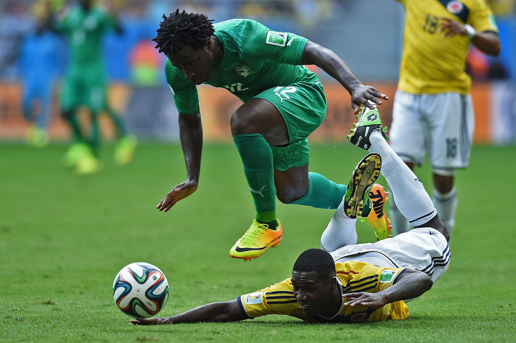 . Colombia\'s defender Cristian Zapata (R) is fouled by Ivory Coast\'s forward Wilfried Bony during the Group C football match between Colombia and Ivory Coast at the Mane Garrincha National Stadium in Brasilia during the 2014 FIFA World Cup on June 19, 2014.  AFP PHOTO / PEDRO UGARTEPEDRO UGARTE/AFP/Getty Images