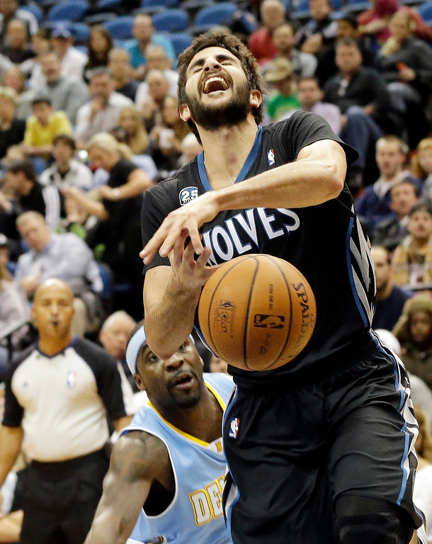 . Minnesota Timberwolves\' Ricky Rubio, right, of Spain, loses the ball as Denver Nuggets\' Ty Lawson defends in the first quarter of an NBA basketball game on Wednesday, Nov. 27, 2013, in Minneapolis. (AP Photo/Jim Mone)