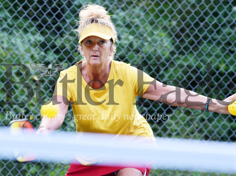 Harold Aughton/Butler Eagle: Jackie Bullman of East Brady attempts a return during a recent pickle ball game at Ritts Park in Butler Wednesday, August 12, 2020.