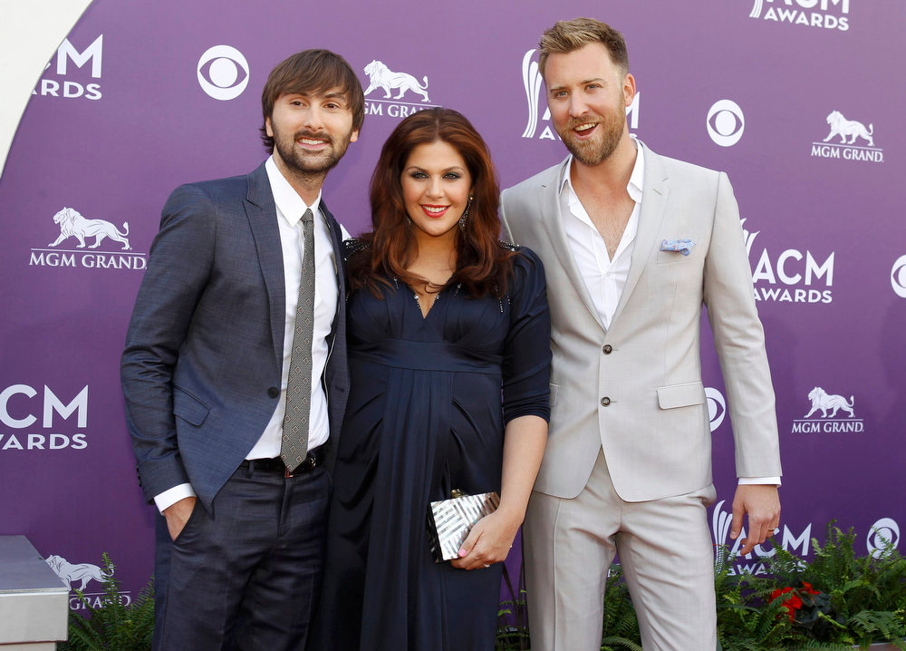 . Members of the band Lady Antebellum, Dave Haywood (L), Hillary Scott and Charles Kelley, arrive at the 48th ACM Awards in Las Vegas, April 7, 2013.  REUTERS/Steve Marcus
