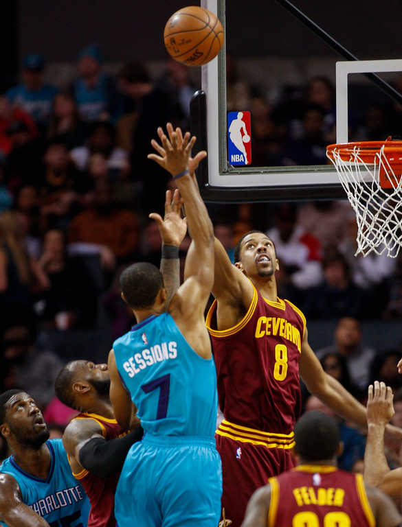 . Charlotte Hornets guard Ramon Sessions (7) shoots over Cleveland Cavaliers forward Channing Frye (8) in the second half of an NBA basketball game in Charlotte, N.C., Saturday, Dec. 31, 2016. Cleveland won 121-109. (AP Photo/Nell Redmond)