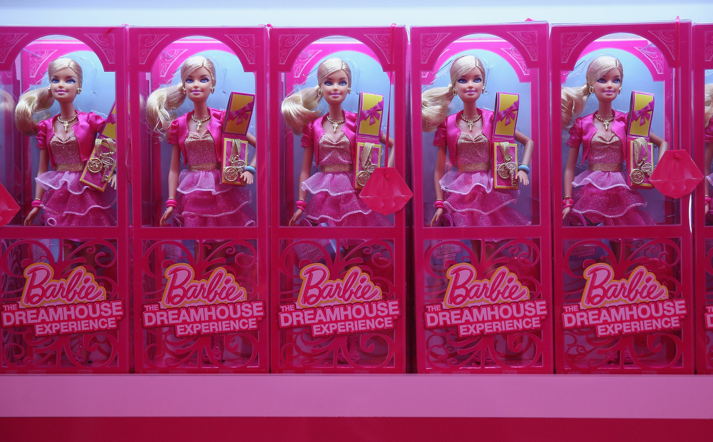 . Barbie dolls and other souvenirs line shelves at the merchandising shop at the Barbie Dreamhouse Experience on May 16, 2013 in Berlin, Germany. The Barbie Dreamhouse is a life-sized house full of Barbie fashion, furniture and accessories and will be open to the public until August 25 before it moves on to other cities in Europe.  (Photo by Sean Gallup/Getty Images)