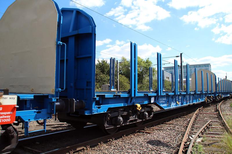 New Colas Log Wagon IWA 83.84.3523043-1 on 6z47 Dollands Moor-Gloucester passing Mitre Bridge Jct 31/08/12.