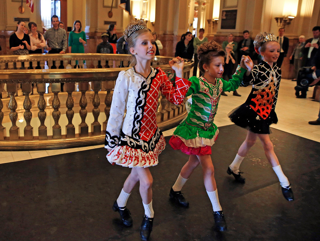 . Young students from the Wick School of Irish Dance perform in celebration of St. Patrick\'s Day, inside the state Capitol, in Denver, Monday March 17, 2014. (AP Photo/Brennan Linsley)