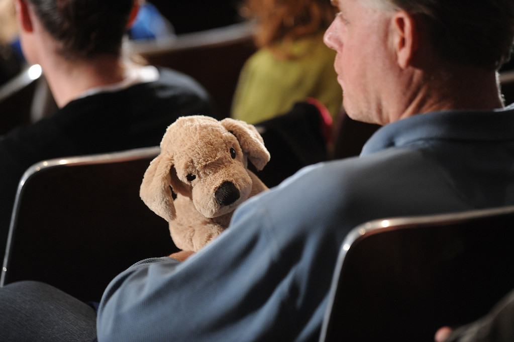 . A man holds a stuffed toy before U.S. President Barack Obama arrives to speak at a memorial service for victims of the Sandy Hook Elementary School shooting at Newtown High School in Newtown, Connecticut, U.S., on Sunday, Dec. 16, 2012. Obama arrived in Newtown, Connecticut, two days after the tragedy and as authorities were still trying to piece together a motive for the second-deadliest mass shooting in the U.S. Photographer: Olivier Douliery/Pool via Bloomberg