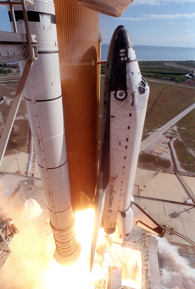 . The left side of the Space Shuttle Columbia is seen during launch on January 16, 2003 at Kennedy Space Center at Cape Canaveral, Florida. Columbia Accident Investigation Board investigators say that a culture of low funding, strict scheduling and an eroded safety program at NASA doomed the flight of the space shuttle. (Photo by NASA/Getty Images)