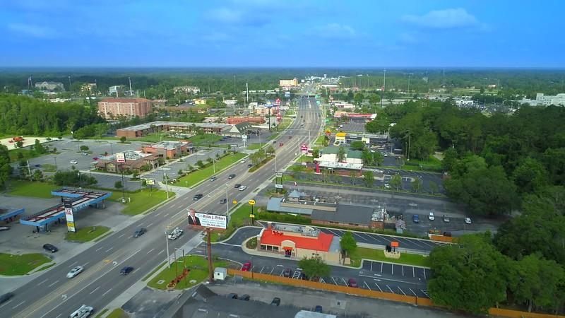 Aerial video Lake city Florida shopping plaza center 4k