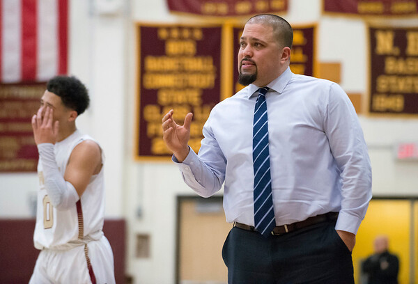 02/18/20 Wesley Bunnell | Staff New Britain boys basketball was defeated at home by Glastonbury on Tuesday night. Head coach Kurt Reis watches the play during the third period.