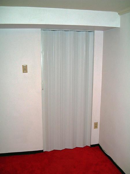 July 18, 2004:  A new door for the basement bonus room .  .  .