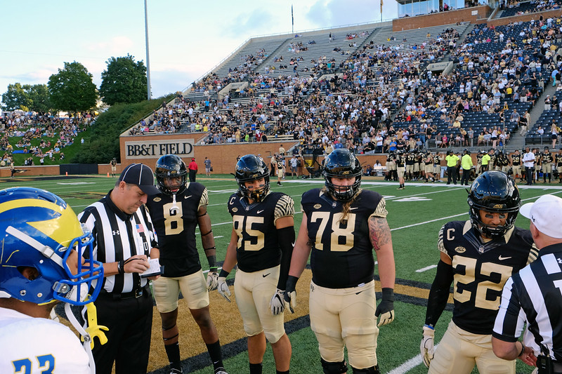 Coin toss with captains.jpg