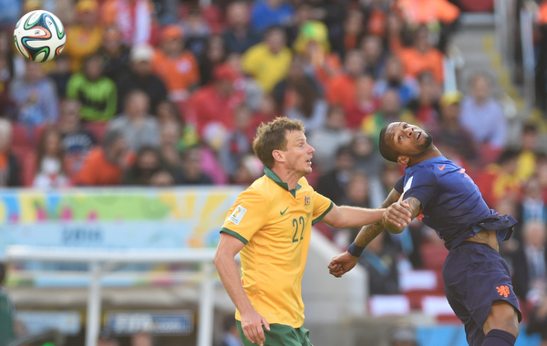 . Australia\'s defender Alex Wilkinson (L) vies with Netherlands\' midfielder Georginio Wijnaldum during a Group B football match between Australia and the Netherlands at the Beira-Rio Stadium in Porto Alegre during the 2014 FIFA World Cup on June 18, 2014.       (JUAN BARRETO/AFP/Getty Images)