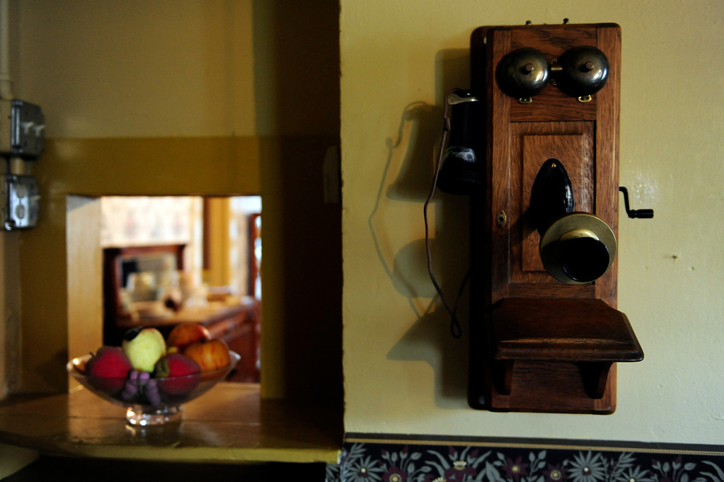 . GOLDEN, CO - MAY 14: A telephone on the wall of the kitchen at the Astor House Museum on May 14, 2014, in Golden, Colorado. The museum will soon undergo structural renovations to fix degrading elements of its foundation. While the museum is closed to complete these renovations, exhibits and artifacts will be updated to better reflect its history as a boarding house. (Photo by Anya Semenoff/The Denver Post)