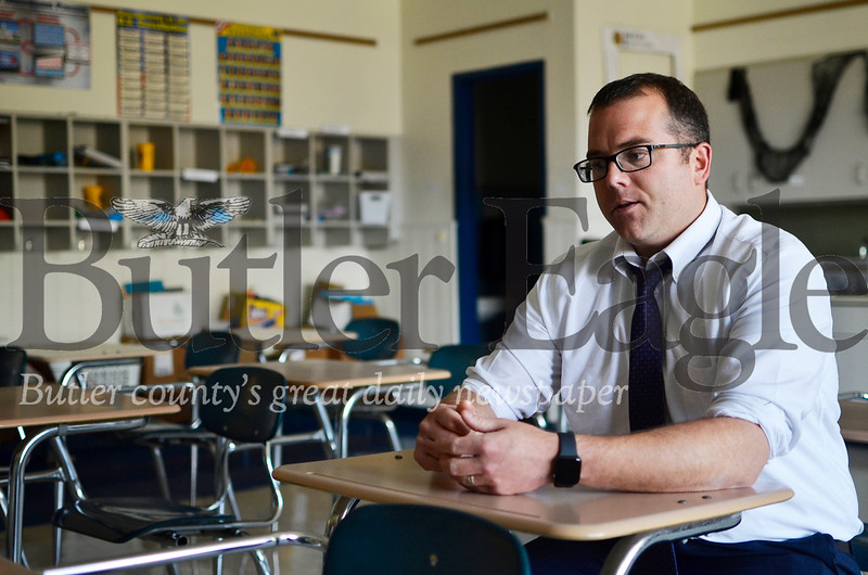 Keenan McGaughey, principal of Center Avenue Community School, talks about students with family addiction issues in a classroom at his school. Tanner Cole/Butler Eagle