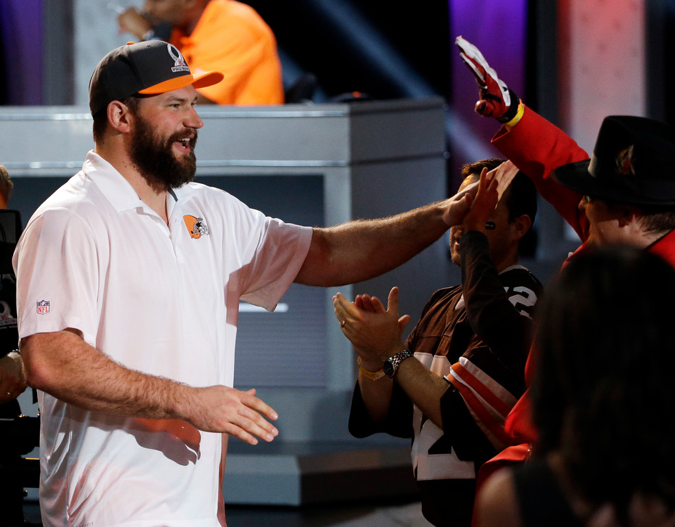 . Cleveland Browns Joe Thomas celebrates with fans after being picked during the NFL football Pro Bowl draft Wednesday, Jan. 21, 2015, in Phoenix. (AP Photo/David J. Phillip)