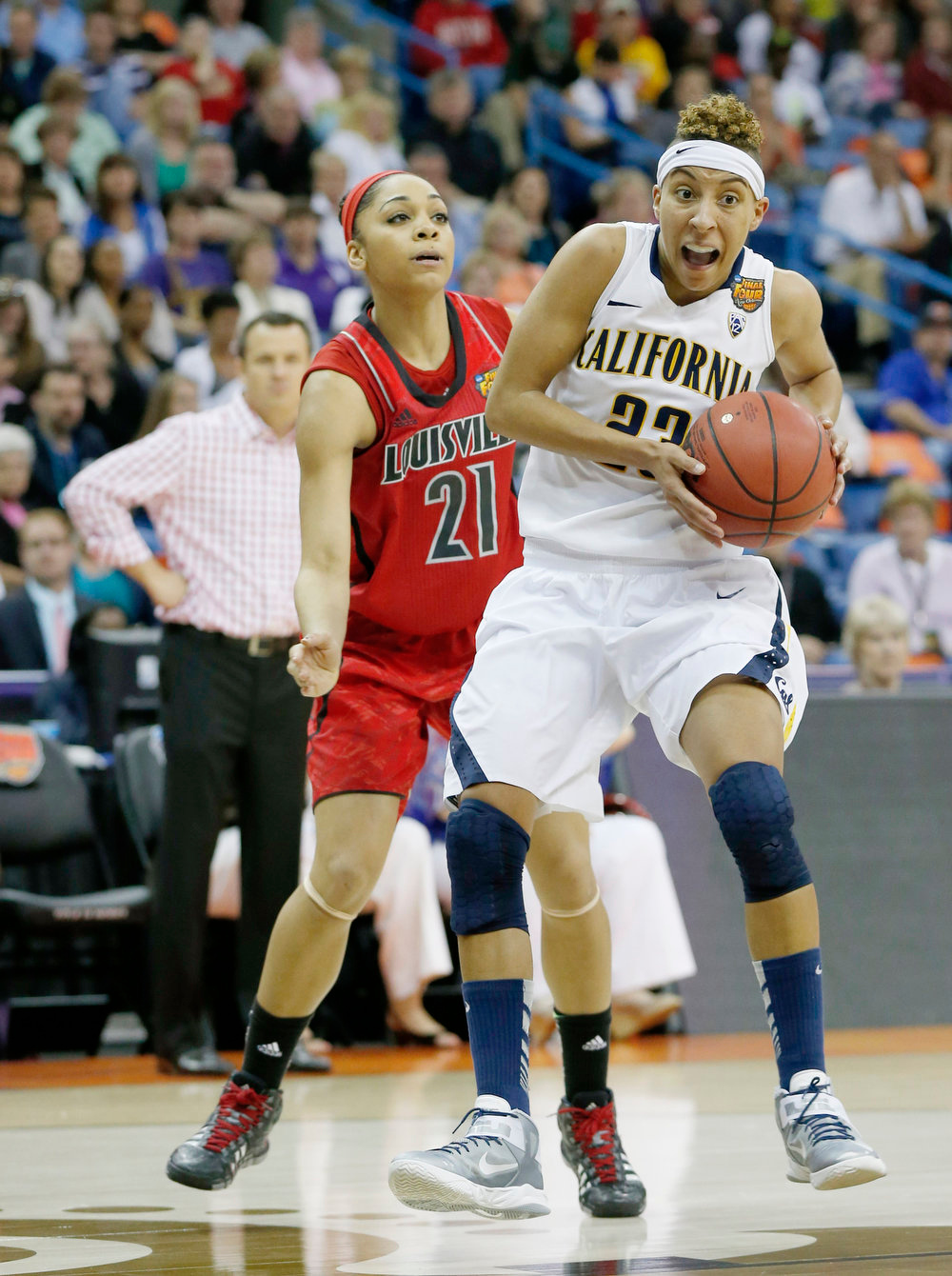 Description of . California guard Layshia Clarendon (23) drives against Louisville guard Bria Smith (21) in the first half of a national semifinal at the Women's Final Four of the NCAA college basketball tournament, Sunday, April 7, 2013, in New Orleans. (AP Photo/Dave Martin)
