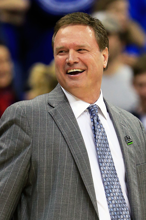 . KANSAS CITY, MO - MARCH 22:  Head coach Bill Self of the Kansas Jayhawks smiles in the second half against the Western Kentucky Hilltoppers during the second round of the 2013 NCAA Men\'s Basketball Tournament at the Sprint Center on March 22, 2013 in Kansas City, Missouri.  (Photo by Jamie Squire/Getty Images)