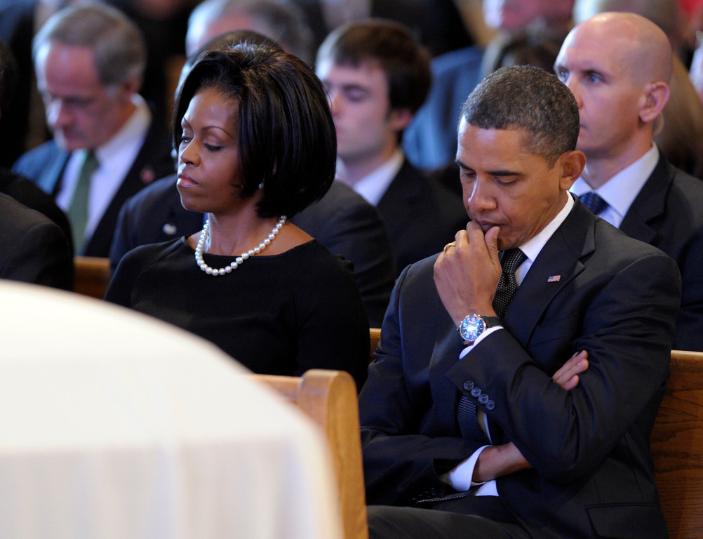 . President Barack Obama and first lady Michelle Obama attend the funeral Mass for Jean Biden, mother of Vice President Joe Biden, Tuesday, Jan. 12, 2010, at the Immaculate Heart of Mary Catholic Church in Wilmington, Del. (AP Photo/Susan Walsh, Pool )
