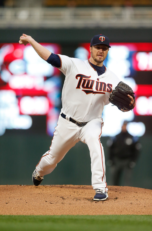 . Minnesota Twins pitcher Phil Hughes throws against the Cleveland Indians in the first inning of a baseball game Tuesday, April 18, 2017, in Minneapolis. (AP Photo/Jim Mone)
