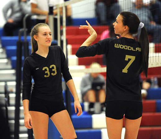 9/27/2018 Mike Orazzi | Staff Woodland's Sydnie Overby (33) and Stephanie Krebbs (7) Thursday night in Bristol.