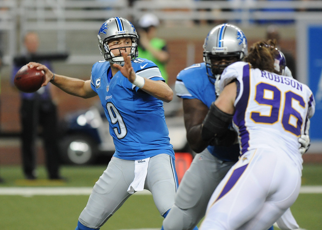 . Detroit Lions quarterback Matthew Stafford, far left, looks to pass against the Minnesota Vikings during first quarter action.  Photo taken on Sunday, September 30, 2012, at Ford Field in Detroit, Mich.  (Special to The Oakland Press/Jose Juarez)