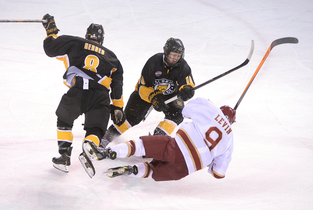 . DENVER, CO. - FEBRUARY 21, 2014: Colorado College wing Luc Gerdes (8) leveled Denver wing Gabe Levin (9) in front of Tigers\' center Cody Bradley (10) in the first period. The University of Denver hockey team hosted Colorado College at Magness Arena Friday night, February 21, 2014. Photo By Karl Gehring/The Denver Post