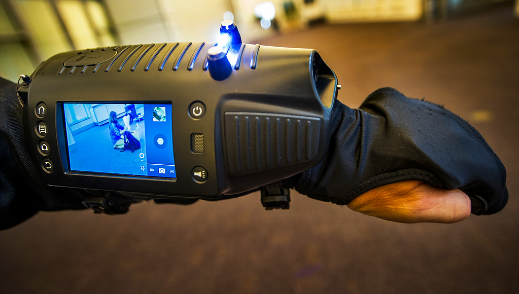 . David Brown, founder/CEO of ArmStar, wearing ArmStar on his arm, the future of self defence.  ArmStar Mission is to safely and effectively control crowds, control violence and save lives.  ArmStar contains stunner module, LED flashlight, Laser Pointer, Camera, Video Camera, Built-in speaker  & microphone, form fitting glove, finger tripper activation, touch screen interface, quick charge battery , protective polymer shell.   Wearable Tech LA is the first entertainment and health wearable conference held in Los Angeles. The event showcase wearable technology, which is currently the fastest growing category in technology July 17, 2014 at the Pasadena Convention Center.(Photo by Walt Mancini/Pasadena Star-News)