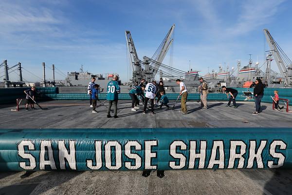 Photos: Sharks play aboard the USS Hornet Aircraft Carrier