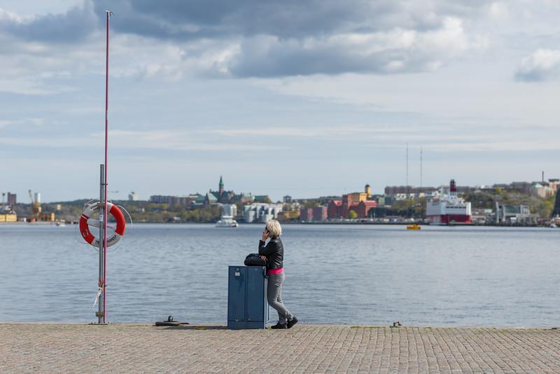 Woman on a quay, Stockholm, April 2015