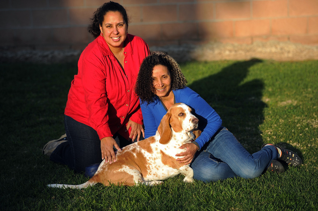 . Sisters Gloria and Patricia Nazario with Patricia�s basset hound Pancho Villa at their Sylmar home Wednesday, February 5, 2014. Pancho Villa has been accused of attacking letter carrier Larry Ortega twice. In one attack Ortega alleges Pancho Villa hid in some bushes in order to ambush the postman. Ortega has filed a $26,500 civil claim against the home insurance of Gloria and Patricia Nazario. (Photo by Hans Gutknecht/Los Angeles Daily News)
