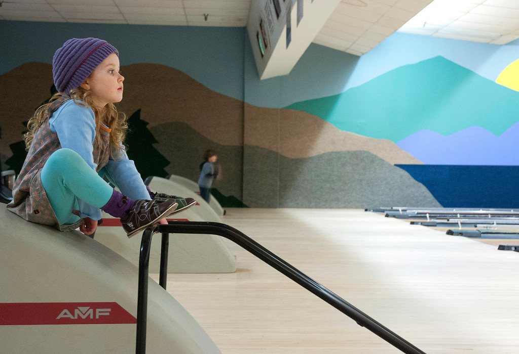 . Kayla Rice/Reformer Ocea Coursen, 4, of Guilford sits and watches her brother bowl at Brattleboro Bowl on Tuesday afternoon.