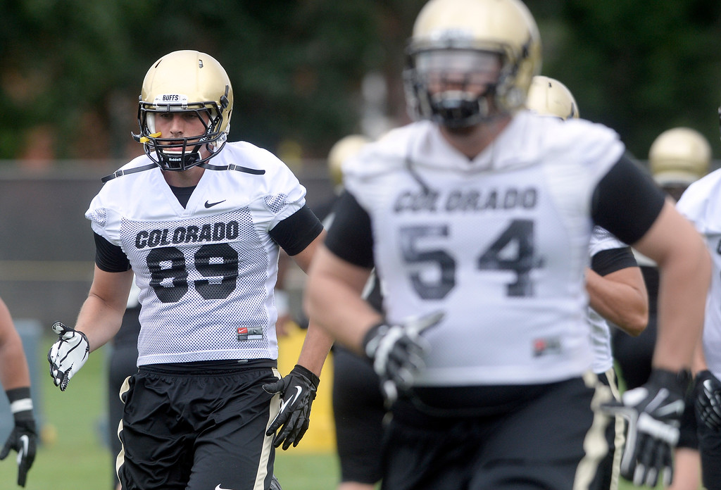 . University of Colorado\'s Austin Ray, at left, runs a drill during the second fall football practice on Wednesday, Aug. 7, at the CU practice fields. For more photos of practice go to www.dailycamera.com Jeremy Papasso/Camera