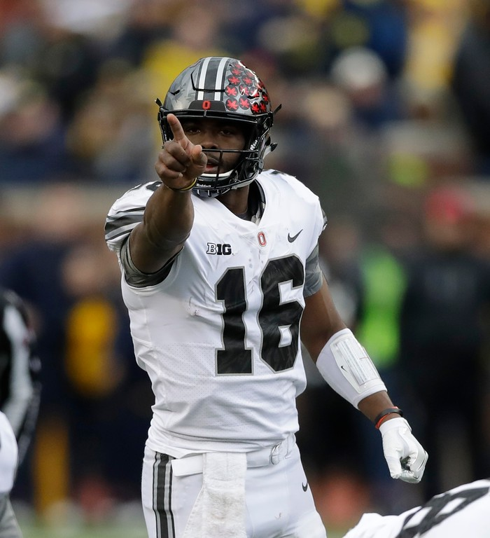 . Ohio State quarterback J.T. Barrett (16) sends signals to his team during the first half of an NCAA college football game against Michigan, Saturday, Nov. 25, 2017, in Ann Arbor, Mich. (AP Photo/Carlos Osorio)