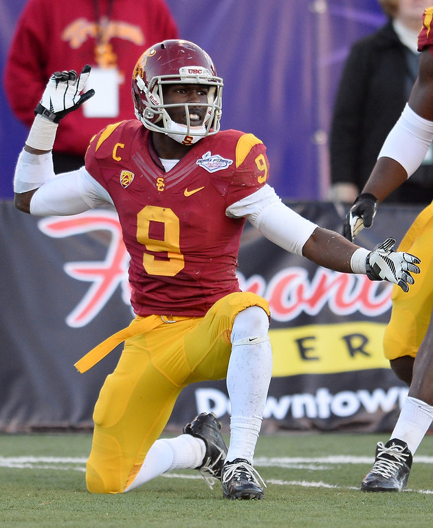 . LAS VEGAS, NV - DECEMBER 21:  Marqise Lee #9 of the USC Trojans reacts after getting a first down against the Fresno State Bulldogs during the Royal Purple Las Vegas Bowl at Sam Boyd Stadium on December 21, 2013 in Las Vegas, Nevada. USC won 45-20.  (Photo by Ethan Miller/Getty Images)