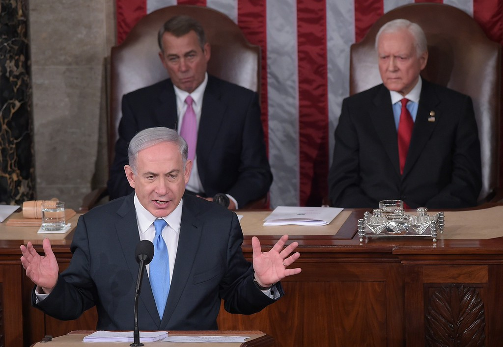 . Israel\'s Prime Minister Benjamin Netanyahu addresses a joint session of the US Congress on March 3, 2015 at the US Capitol in Washington, DC. Netanyahu was invited by House Speaker John Boehner to address Congress without informing the White House. Looking on are House Speaker John Boehner(L) and  President pro tempore of the Senate Sen. Orrin Hatch. AFP PHOTO / MANDEL  NGAN/AFP/Getty Images