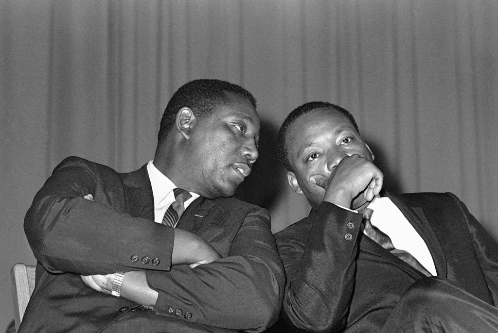 . Dr. Martin Luther King and Charles Evers, NAACP field secretary together in Jackson, Miss., March 20, 1968. (AP Photo/Jack Thornell))