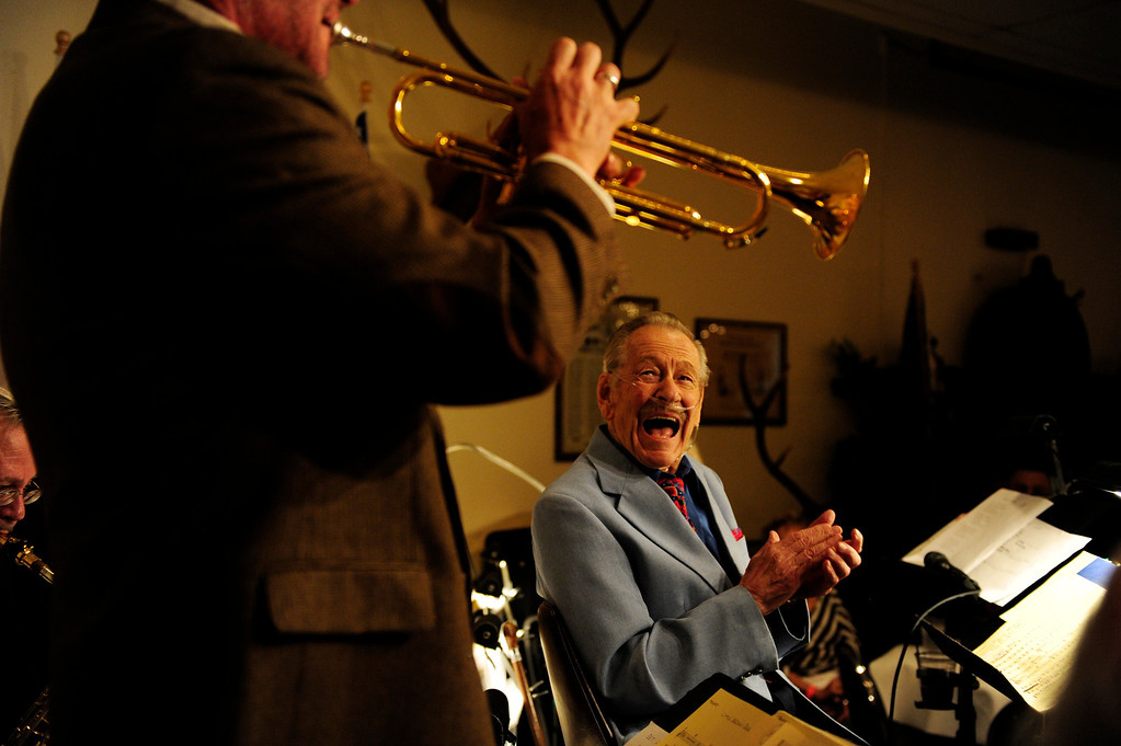. Gordon Dooley, 91, smiles as his trumpeter Charlie Smith plays a solo during The Battle of the Big Bands, a fundraiser hosted at the Lakewood Elks Lodge on Sunday, September 16 2012. Dooley came out of retirement two days after his 91st birthday to lead his group. Proceeds from the event will be donated to the West Metro Fire and Rescue Foundation. AAron Ontiveroz, The Denver Post