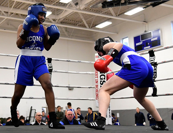 3/15/2019 Mike Orazzi | Staff Penn State's Hannah Temple (red) and UConn's Gail Mitchell (blue) in a 125 match during the National Collegiate Boxing Association National Qualifier held at the Bristol Boys & Girls Club in Bristol, Conn. Friday evening.