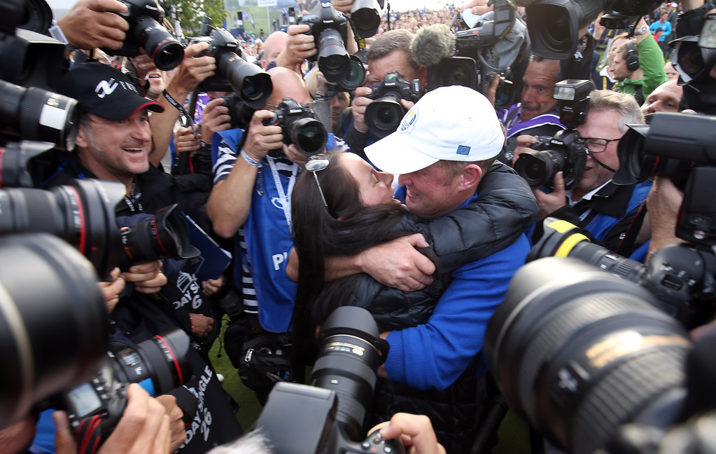. Europeís Jamie Donaldson and his fiancee Kathryn Tagg, surrounded by the media, celebrate winning the 2014 Ryder Cup golf tournament at Gleneagles, Scotland, Sunday, Sept. 28, 2014. (AP Photo/Peter Morrison)